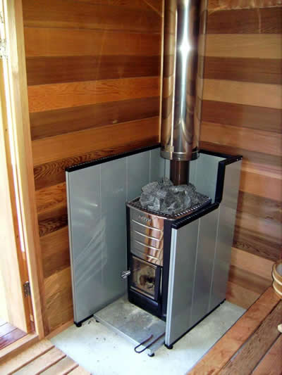 Wood fired heater with protective shield