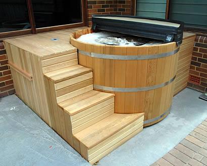 Ukko tub with custom stairs and enclosure