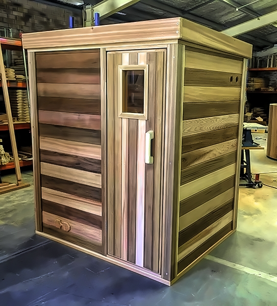 Log sauna with traditional door