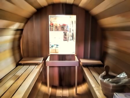 Barrel sauna with window at the back